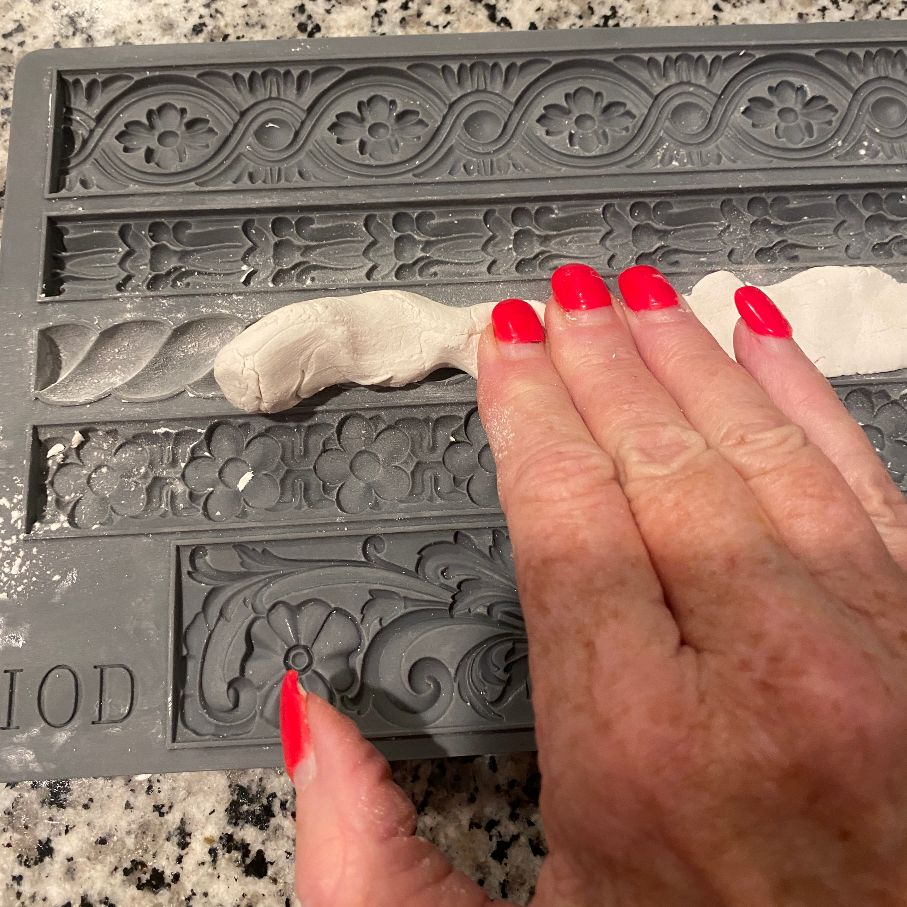 press clay into mould
